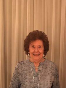 Helen Landow smiles at the camera.