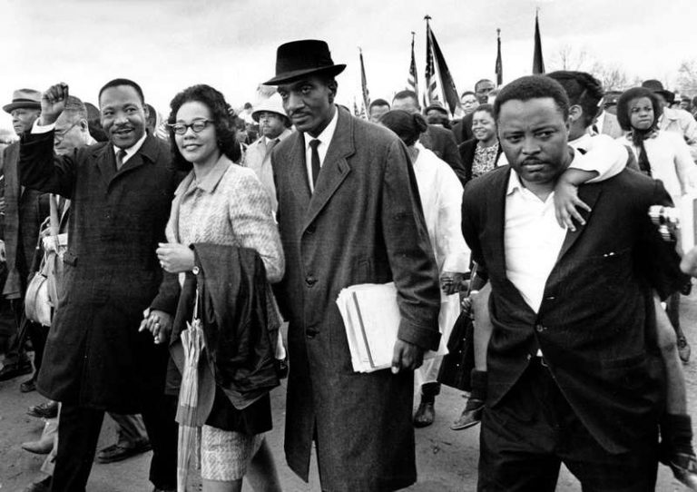 Martin Luther King Jr., and his wife, march in Washington D.C. circa 1960s.