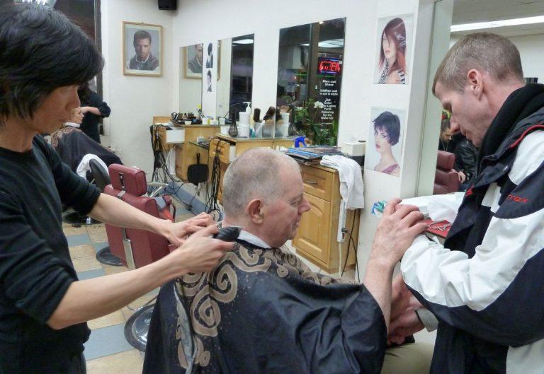 Cyril Cassell getting his hair cut